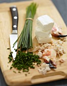 Preparing the Fromage frais with chives and crab meat