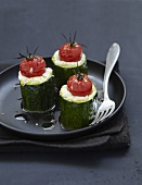 Zucchinis stuffed with goat's cheese Buchettes and cherry tomatoes