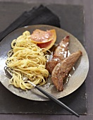 Caramelized duck Aiguillettes with grapefruit and spaghettis