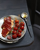 Roasted salmon with Chorizo scales and cherry tomatoes
