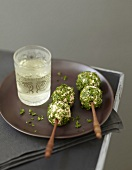 Salmon and parsley appetizers on sticks