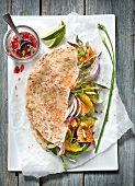 Grilled salmon and orange salad coconut galette with sweet and sour sauce