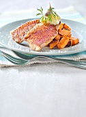 Red mullet fillets with pureed garlic and roasted sweet potatoes