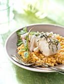 Roasted piece of cod with spring garlic and orange lentils