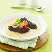 Black pudding with onion cream