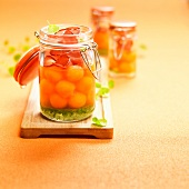 Melon ball salad with bacon and herb jelly