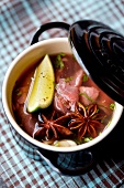 Thinly sliced beef broth with lime and star anise