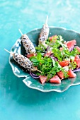 Rocket lettuce,watermelon,quinoa and brocciu salad,chicken brochettes coated in black and golden sesame seeds