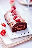 Chocolate and raspberry Christmas log cake