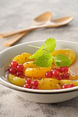 Apricot and redcurrant syrupy fruit salad