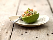 Salmon and gren apple tartare served in half an avocado