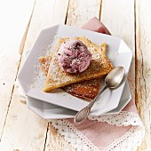 Pancakes with grated coconut and a scoop of cherry ice cream