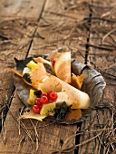 Tuiles with fruit salad and black trumpet mushrooms