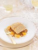 Tuna mousse terrine on breadcrumbs and mandarin orange