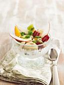 Sliced fruit with yoghurt ice cream and basil