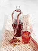 Bottle and glass of hibiscus juice