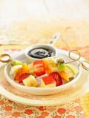 Fresh fruit brochettes with carouba sauce