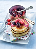 Pancakes with stewed blackcurrants and raspberries
