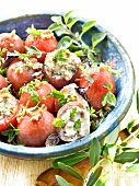 Tomatoes stuffed with fromage frais, chopped olives and herbs