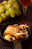 Quail with white grapes