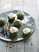 Spinach and nuoc-mâm mini muffins with goat's cheese mousse