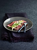 Cold sliced roast beef with lemon grass and chives