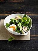 Spinach, mushroom and soft-boiled quail's egg salad