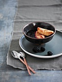 Roasted quince with blackberry coulis
