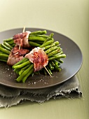 Bundles of green bens tied with grilled strips of bacon