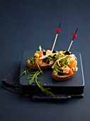 Smoked tuna tartare, olives and parmesan on toasts