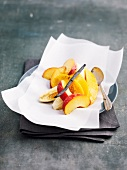 Fruit with vanilla and honey cooked in wax paper