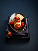 Balsamic-flavored strawberry and cherry tomato pancake wrap