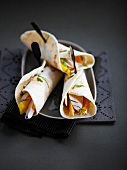 Sliced chicken breast, mango and mint wraps