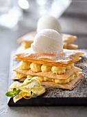 Crispy lemon cream Mille-feuille topped with a scoop of lemon sorbet