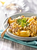 Chicken simmered with olives,lemon,potatoes and saffron