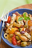 Chicken simmered with olives,tomatoes,eggplants,raisins and pinenuts