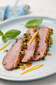 Duck magret in pistachio crust with orange coulis