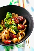Noodles with Chinese sausages and broccoli