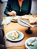 Person eating a slice of lemon meringue pie