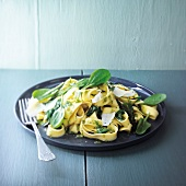 Pasta with pesto and baby spinach