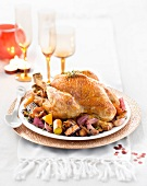 Capon stuffed with gingerbread and served with apples, mushrooms and old-fashioned vegetables