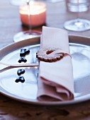 Chocolate letters and a shortbread napkin ring