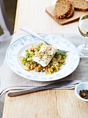 Cod with herbs and bulghour with dill and celery stalks