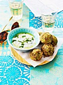 Chicken and herb meatballs with minty yoghurt sauce