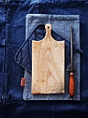 Chopping board and knife sharpener