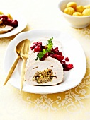 Roast turkey stuffed with dried fruit and cranberry sauce
