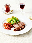 Duck fillet with gravy,fig and pear chutney,rocket lettuce with lemon zests,polenta galettes