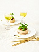 Foie gras on toast garnished with stewed onions and corn lettuce