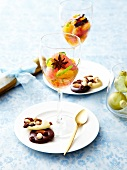 Spicy and minty citrus fruit salad, dark and white chocolate Mendiants