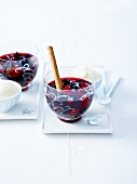 Spicy summer fruit soup with yoghurt ice cream